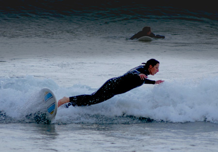 Laura surfs at Trighe Mhor